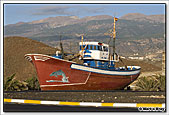 An old fishing boat parked up against the motorway roundabout at Poris de Abona, 30th November 2009